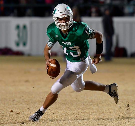Hamlin quarterback Braydin Warner looks for running room against Albany on Nov. 8.