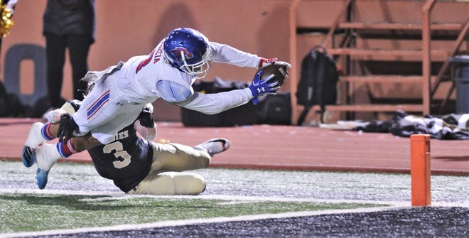 Cooper running back Noah Garcia stretches for an 18-yard touchdown run as Amarillo High's Jake Maynard (3) tries to stop him. The touchdown tied the game at 7 with 1:07 left in the first quarter. Amarillo High won 49-35 to claim the District 2-5A Division I title Friday, Nov. 8, 2019, at Dick Bivins Stadium in Amarillo.