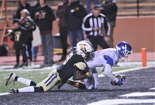 Cooper receiver Dylon Davis falls into the end zone for a 9-yard touchdown catch as Amarillo High's Cayden Johnson defends. The TD pulled Cooper within 42-35 with 3:10 left in the game. Amarillo High won 49-35 to claim in the District 2-5A Division I title Friday at Dick Bivins Stadium in Amarillo.