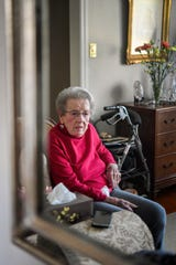 Margaret Swicegood Fort is reflected in a mirror in her home in Arden November 6, 2019. Fort will turn 100 years old November 12.