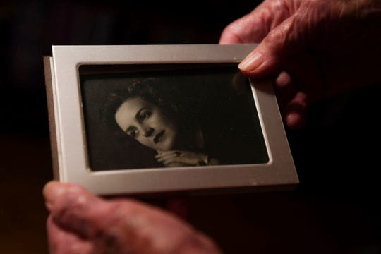 Margaret Swicegood Fort holds a photograph of herself in her 20's in her home in Arden November 6, 2019. Fort will turn 100 Nov. 12.