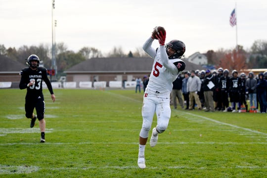 Livonia Churchill wide receiver Brendan Lowry (5) catches a pass and scores a touchdown during the Division 2 district championship on Saturday, Nov. 9, 2019 at Lakeview High School in Battle Creek, Mich.