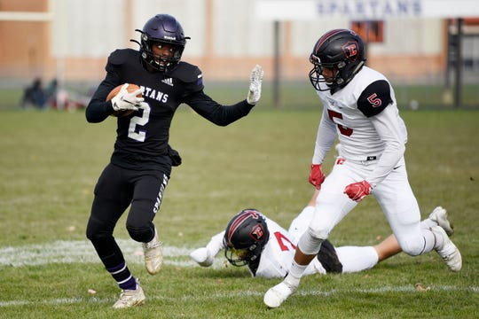 Lakeview running back Frank Tatum (2) rushes the ball as Livonia Churchill safety Brendan Lowry (5) covers him during the Division 2 district championship on Saturday, Nov. 9, 2019 at Lakeview High School in Battle Creek, Mich.