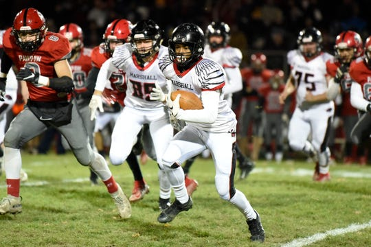 Marshall running back Thailan Taylor (3) rushes the ball during the Division 4 district championship against Paw Paw on Friday, Nov. 8, 2019 at Paw Paw High School.