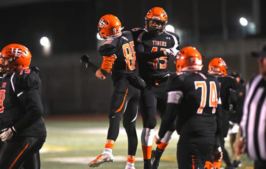 Union-Endicott's Nicholas Coletti (86) and Mekhi Belecher celebrate during the Section 4 Class A final against Vestal on Friday. Nov. 8, 2019.
