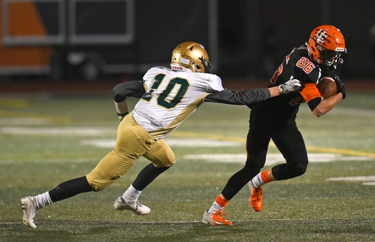 Vestal's Alex Thrasher attempts to tackle Union-Endicott's Nicholas Coletti in the second quarter of Friday's Section 4 Class A final at U-E.