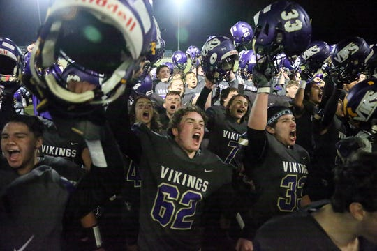 North Kitsap players celebrate after defeating Fife at North Kitsap on Friday, November 8, 2019. North advances into the state 2A playoffs.