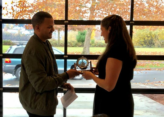 Jeremy McCrimmon gives a clock to Angela Mirardor Saturday at Seaside Church near Evergreen-Rotary Park. Mirador, McCrimmon's neighbor, saved his life earlier this year when he went into cardiac arrest.