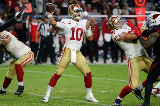 San Francisco 49ers quarterback Jimmy Garoppolo (10) throws against the Arizona Cardinals during the second half of an NFL football game, Thursday, Oct. 31, 2019, in Glendale, Ariz.
