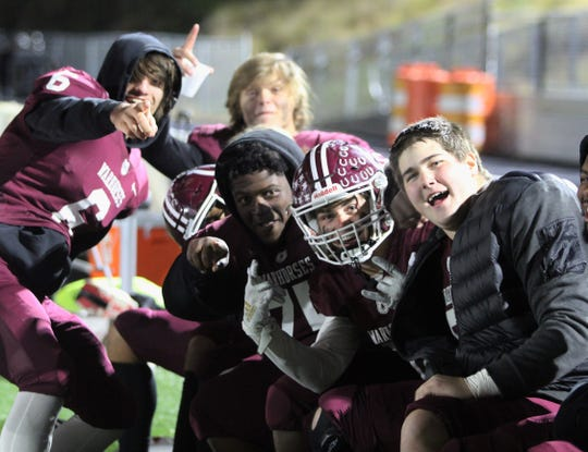 Owen players celebrate on the sidelines during their 62-8 victory over Madison on Nov. 8.