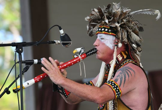 Ed WindDancer performs for the crowd on the first day of the Native Rhythms Festival Saturday at the Wickham Park amphitheater. The 11th annual festival continues Sunday 9-6.