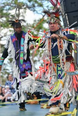 Dancers performa a Native American grass dance during the Native Rhythms Festival Saturday at the Wickham Park amphitheater. The 11th annual festival continues Sunday 9-6.