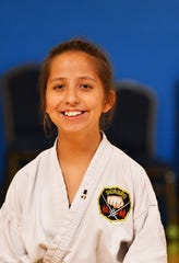 Holly Hammac, 12, recently earned her green belt at the Cocoa Beach Karate School in the traditional Matsubayashi-Ryu (Shorin-Ryu) style karate. The Roosevelt Elementary student was born with Polymicrogyria, secondary left-sided hemisphere cerebral palsy, epilepsy, autism and ADD. She is an inspiration to others students in the class.