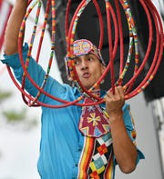 Cody Boettner performs a hoop dance for the crowd on the first day of the Native Rhythms Festival Saturday at the Wickham Park amphitheater. Boettner is current world champion in the Native American dance style. The 11th annual festival continues Sunday 9-6.