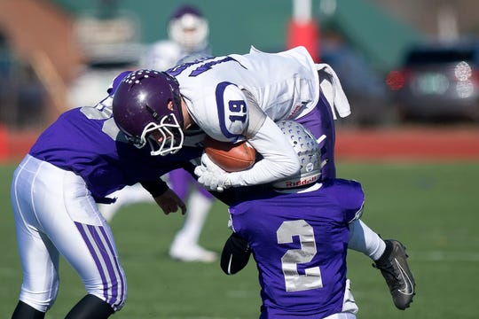 Bellows Falls' Dylan Clark (19) makes a leaping catch during the Division II high school football state championship game in Rutland on Saturday, Nov. 9, 2019.