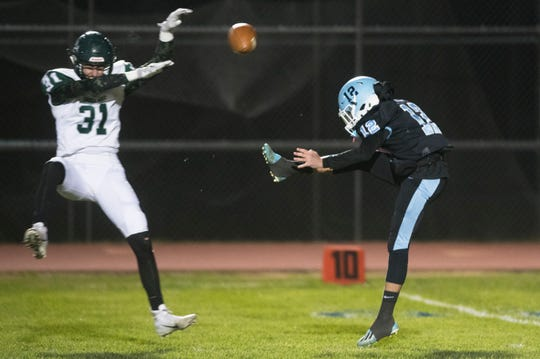Long Branch's Jack Friedman blocks the punt of Highland's Brendon Kehler during the 1st quarter of the South Jersey Group 4 opening round playoff game played at Highland High School in Blackwood on Friday, November 8, 2019.  The ball was recovered by Long Branch's Christian Rodriguez in the end zone for a touchdown.
