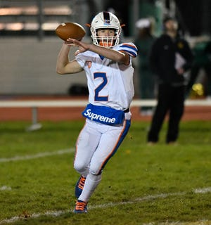 Millville quarterback Nate Robbins looks for an open receiver during a game against Clearview on Friday night. The visiting Thunderbolts topped the Pioneers, 32-24 on Nov. 8, 2019.