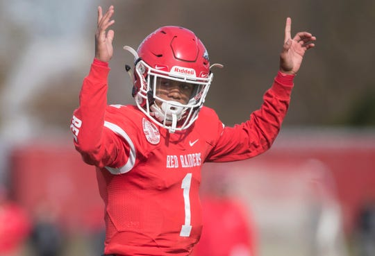 Paulsboro's quarterback Tyree Thomas celebrates after handing the ball to Paulsboro's Bhayshul Tuten for a  touchdown during the 1st quarter of the South Jersey Group 1 opening round football playoff game between Paulsboro and Glassboro, played at Paulsboro High School on Saturday, November 9, 2019.   Paulsboro defeated Glassboro, 20-14.