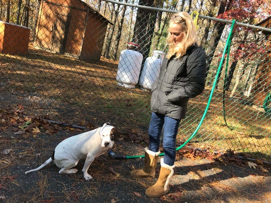 Kathy McGuire and Sweet Pea take in some fresh air and sunshine at McGuire's Winslow Township home.