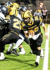 Paint Valley's Lane Mettler runs the ball during a 35-28 loss to Grandview Heights in a Division VI regional quarterfinal game on Friday, Nov. 8, 2019 in Bainbridge, Ohio.