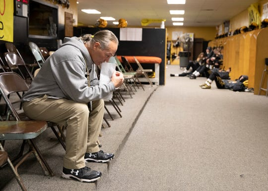 Paint Valley coach Pete Hollon takes a moment to himself before the team prayer at their last home game of the season against Grandview Heights in a Division VI regional quarterfinal game on Friday, Nov. 8, 2019 in Bainbridge, Ohio. Hollon announced his retirement on Thursday after leading the football program for the past 24 years and coaching for 36 years in total.