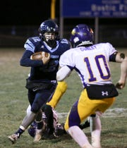 Adena's Preston Sykes carries the ball during a 32-7 loss to Mechanicsburg in a Division VI regional quarterfinal game on Friday, Nov. 8, 2019 in Frankfort, Ohio.