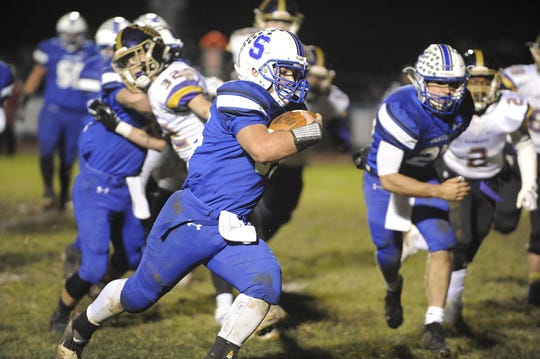 Southeastern running back Mikey Nusser runs the ball during a 40-3 win over Dayton Christian in the D-VI Regional Quarterfinals on Friday, Nov. 8, 2019 at Southeastern High School in Chillicothe, Ohio.