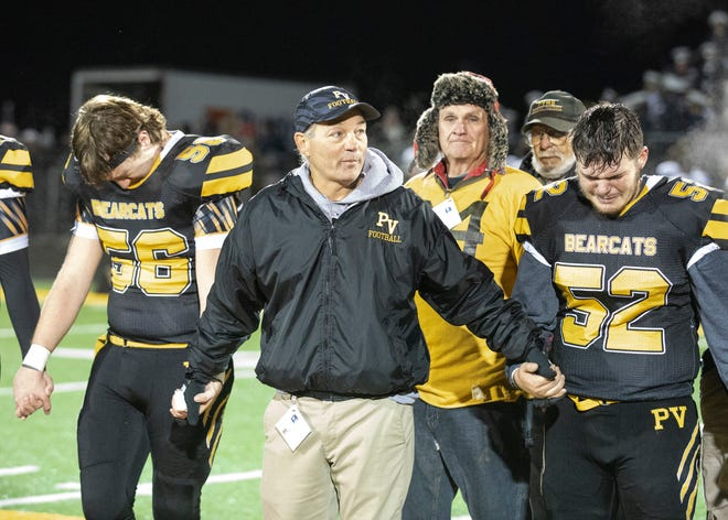 Paint Valley football coach Pete Hollon holds his players hands during a speech after a tough home loss against Grandview Heights in a Division VI regional quarterfinal game on Friday, Nov. 8, 2019 in Bainbridge, Ohio.  Hollon announced his retirement on Thursday after leading the football program for the past 24 years and coaching for 36 years in total.