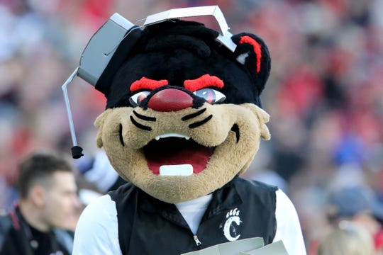 The Cincinnati Bearcat mascot wears a headset in the second quarter of a college football game against the Connecticut Huskies, Saturday, Nov. 9, 2019, at Nippert Stadium in Cincinnati.