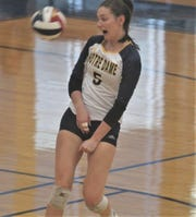 Notre Dame senior Gracie Eckerle ducks out of the way to let the ball go out of bounds for a Panda point as Notre Dame Academy defeated McCracken County 3-0 in the round of 16 of the KHSAA state volleyball tournament November 8, 2019 at Valley High School, Louisville, Ky.
