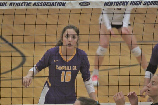 Campbell County senior Kasey Martin prepares for a serve as Campbell County fell 3-2 to Owensboro Catholic in the round of 16 at the KHSAA state volleyball tournament November 8, 2019 at Valley High School, Louisville, KY.