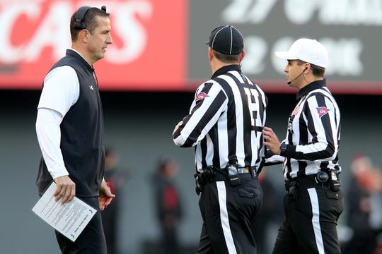 Cincinnati Bearcats head coach Luke Fickell talks with the officials in the second quarter of a college football game against the Connecticut Huskies, Saturday, Nov. 9, 2019, at Nippert Stadium in Cincinnati.