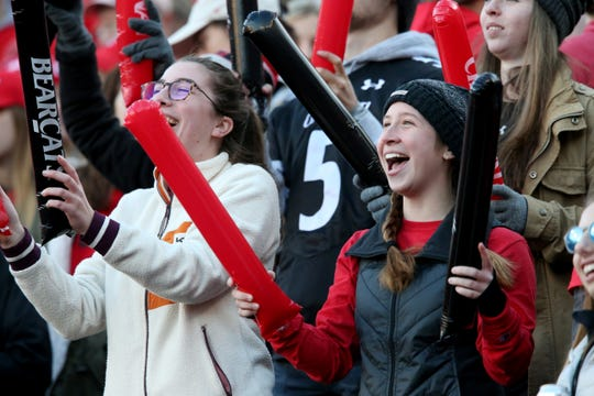 Cincinnati Bearcats fans cheer on the team in the second quarter of a college football game against the Connecticut Huskies, Saturday, Nov. 9, 2019, at Nippert Stadium in Cincinnati.