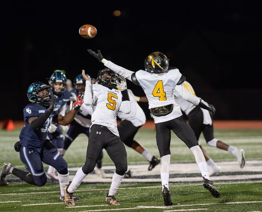 Piscataway's Kristopher Hernandez (number 5) and Aamir Woods (number 4) go for the ball against West Orange on Nov. 8, 2019