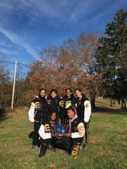 The South Brunswick girls cross country team after winning the 2019 Central Group IV title.