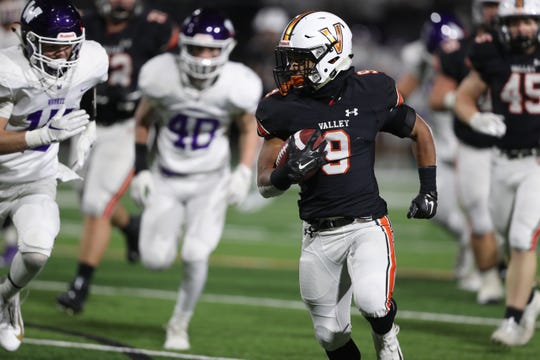 Nov 8, 2019; West Des Moines, IA, USA; Valley Tigers Creighton Mitchell (9) breaks away for a touchdown against the Waukee Warriors at Valley Stadium. The Tigers beat the Warriors 26-10.