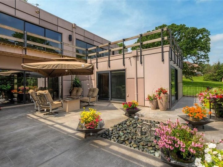 This stunning artist re-designed home has 4,627 square feet and sits on 1.3 acreas of landscaped property just minutes from downtown Des Moines.