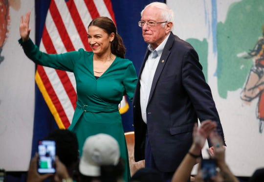 Sen. Bernie Sanders, a current Democratic presidential candidate hopeful, stands alongside U.S. Rep. Alexandria Ocasio-Cortez (D-NY) on Saturday, Nov. 9, 2019, at Drake University in Des Moines.