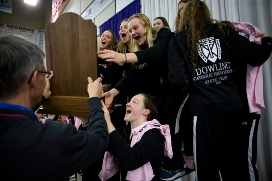 Dowling Catholic celebrates as it accepts the state swimming trophy at the girls state swim meet on Saturday, Nov. 9, 2019 in Marshalltown. Dowling defeated Ames who had won the last four years in a row.