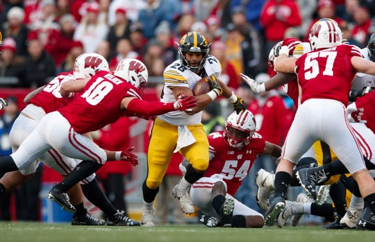 Nov 9, 2019; Madison, WI, USA; Iowa Hawkeyes running back Toren Young (28) runs the football against the Wisconsin Badgers during the second quarter at Camp Randall Stadium.