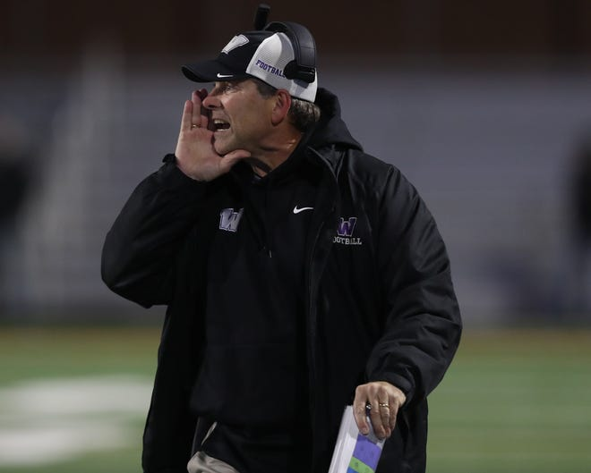 Nov 8, 2019; West Des Moines, IA, USA;  Waukee Warriors head coach Scott Carlson talks to his team during their game with the Valley Tigersat Valley Stadium.