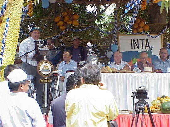Dr. Norman Borlaug was an honorary board member of Self-Help International, pictured here during the release of a new line of high protein corn in Nicaragua, with Self-Help International Country Director Jorge Campos speaking.