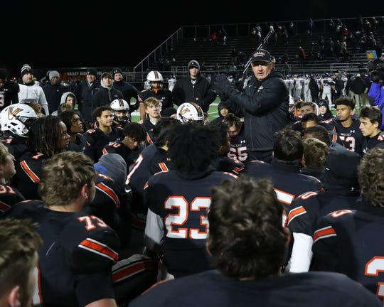 Nov 8, 2019; West Des Moines, IA, USA; Valley Tigers head coach Gary Swenson talks to his team after beating the Waukee Warriors at Valley Stadium. The Tigers beat the Warriors 26-10.