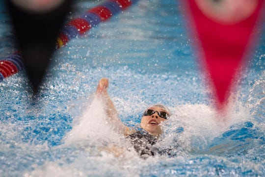 Dowling Catholic's Katie Broderick competes in the 10 0yard backstroke at the girls state swim meet on Saturday, Nov. 9, 2019 in Marshalltown.