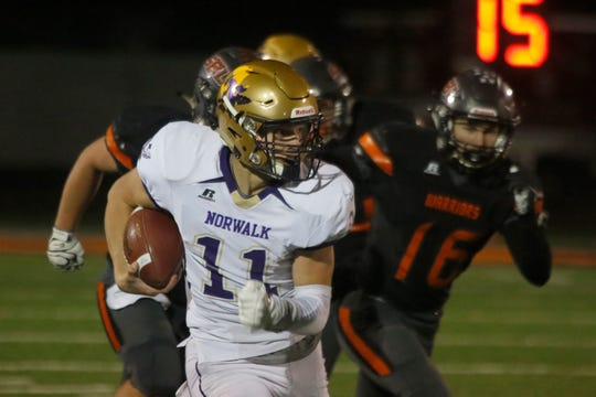 Norwalk senior quarterback Zachary Marker runs for a first down. Norwalk fell 54-28 in a Class 3A state regional final at Sergeant Bluff-Luton on Nov. 8.