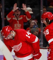 Detroit Red Wings center Robby Fabbri (14) reacts after scoring his second goal of the night during the second period of an NHL hockey game against the Boston Bruins, Friday, Nov. 8, 2019, in Detroit.