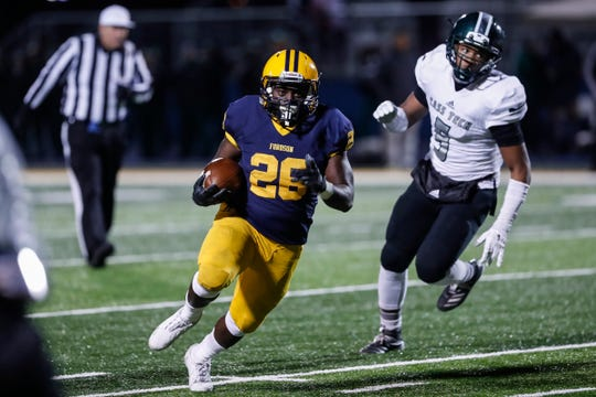Dearborn Fordson running back  KeyShawn Smith (26) runs against Detroit Cass Tech during the first half at Fordson High School in Dearborn, Friday, Nov. 8, 2019.