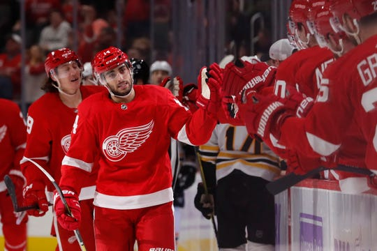 Detroit Red Wings center Robby Fabbri greets teammates after scoring during the first period of an NHL hockey game against the Boston Bruins, Friday, Nov. 8, 2019, in Detroit.