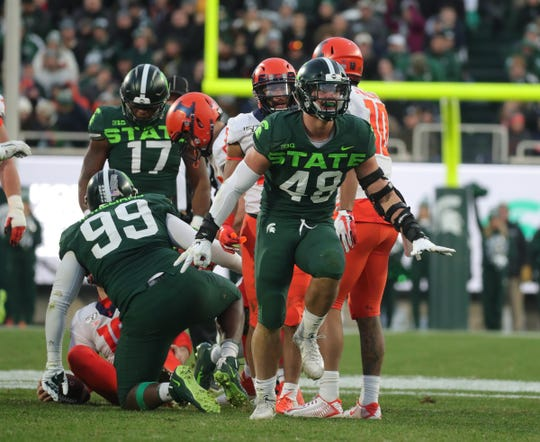 Michigan State Spartans defensive end Kenny Willekes (48) celebrates his sack vs. Illinois during the first half Saturday, Nov. 9, 2019 at Spartan Stadium.