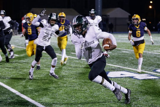 Detroit Cass Tech quarterback Sebastian Brown (7) runs against Dearborn Fordson during the first half at Fordson High School in Dearborn, Friday, Nov. 8, 2019.